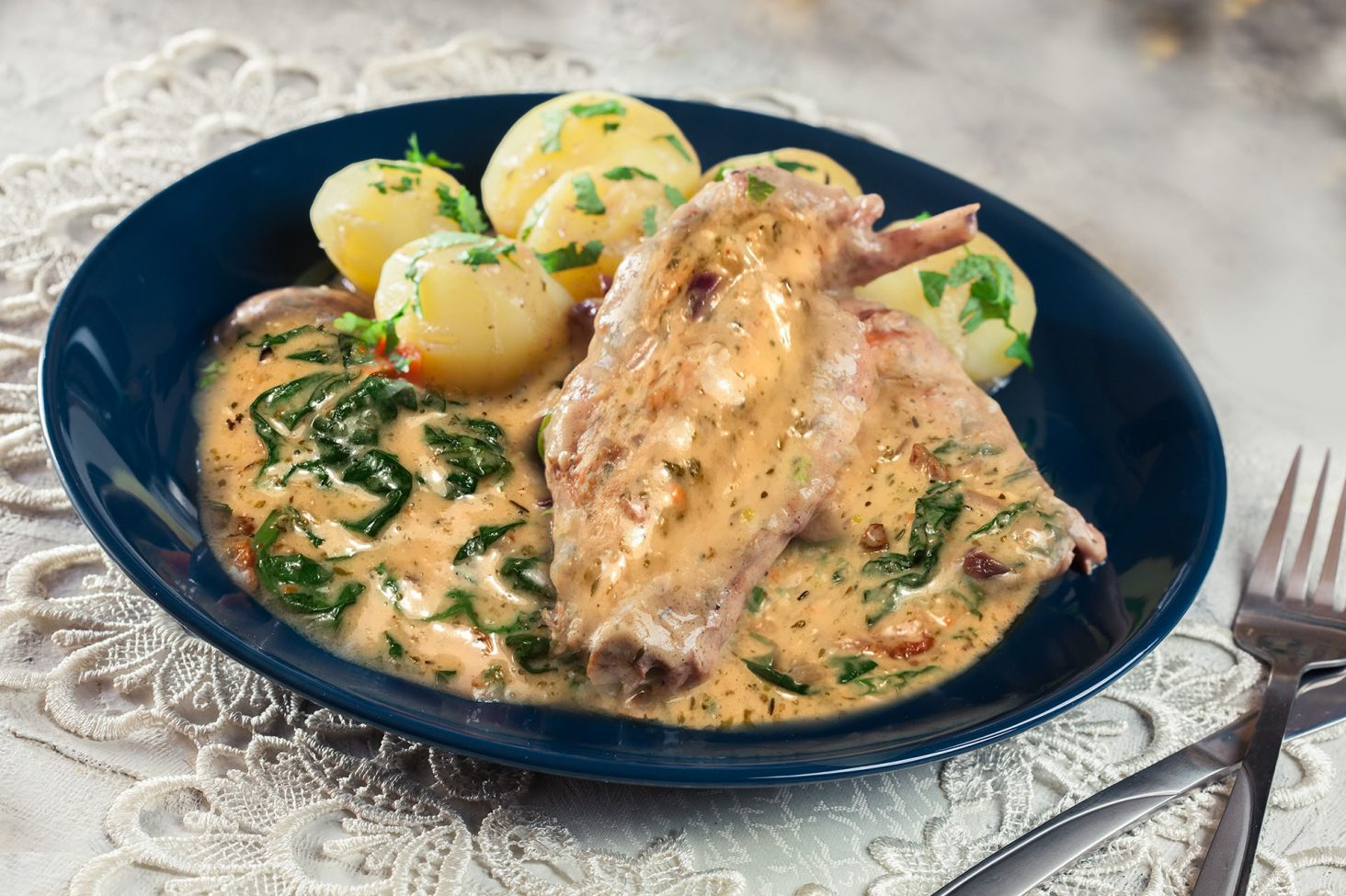 Stewed rabbit legs with vegetables
