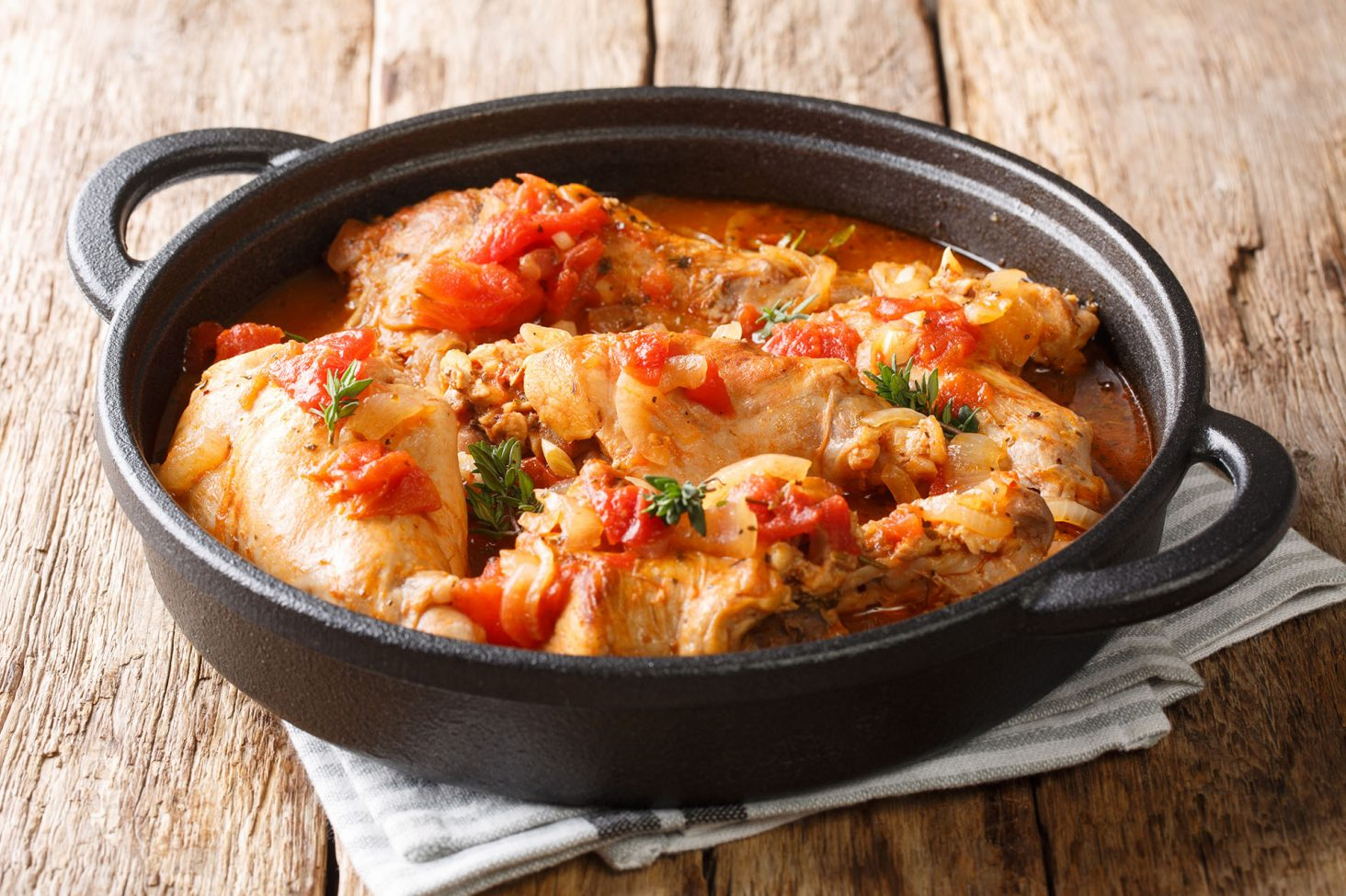 Tasty spicy rabbit stew in tomato sauce with white wine and herb
